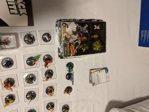 Various comic books and a Street Fighter character game set. for Sale in Grapevine, TX