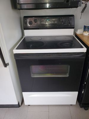 Refrigerator with ice maker and electric stove for Sale in Detroit, MI