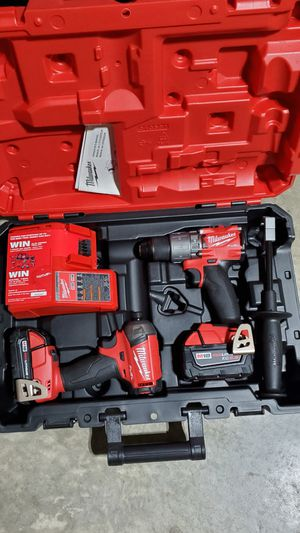Milwaukee m18 fuel combo impact surge ,hammer drill, (2) battery &charger for Sale in San Antonio, TX