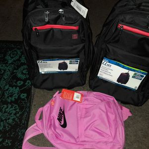"22"" roll backpacks and Pink Nike backpack for Sale in Colton, CA"