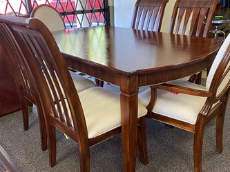 Dining room table with six chairs and leaf extension piece $199.99 delivery options available located at at Hidden Treasures thrift store 7867 Palm R for Sale in Tampa,  FL