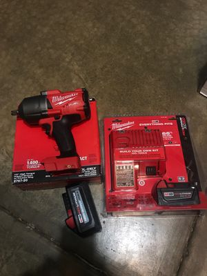 Milwaukee high torque impact wrench 6.0 /5.0 batteries and charger for Sale in Bolingbrook, IL