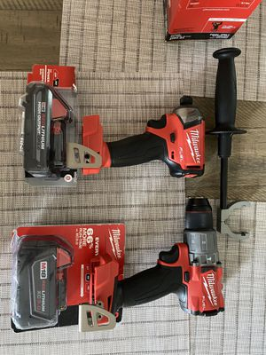 Milwaukee hammer drill 2804-20 & surge impact driver 2760-20 & 5.0 XC & 3.0 CP HO battery for Sale in Lincoln, RI