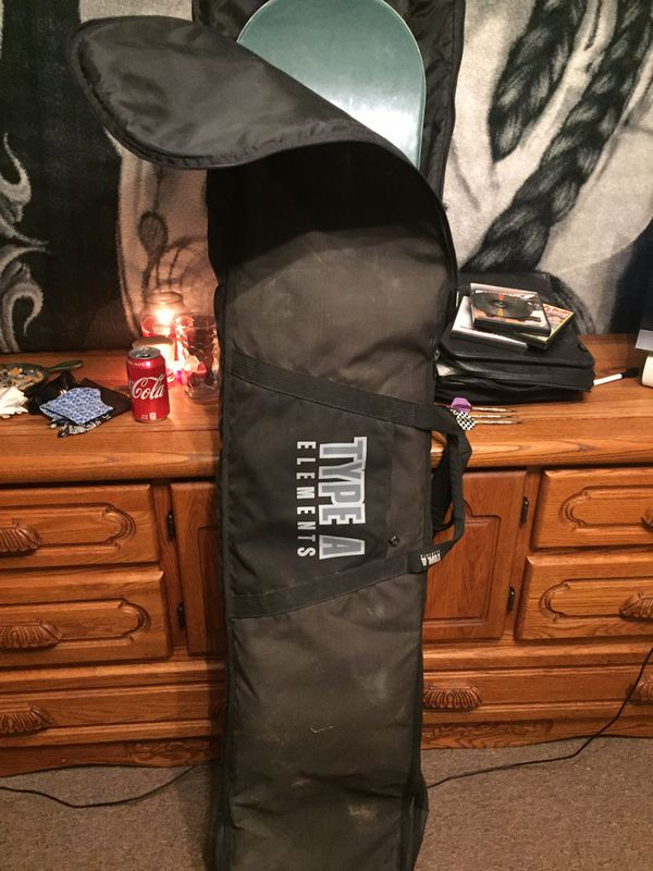 Roan Rogers woman's snowboard 5 foot call with new avalanche bindings Also comes with type a elements snowboard bag with backpack straps
