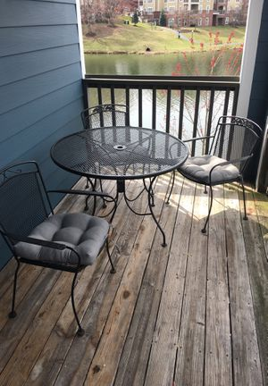 Black rod iron table with three metal chairs for Sale in Centreville, VA