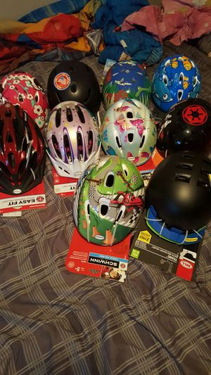 Helmets $10dollars brand new never used summers coming make sure your kids are biking safely. for Sale in Denver, CO