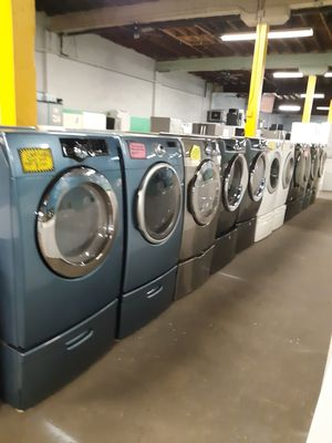 FRONT LOAD WASHER AND DRYER SET WITH PEDESTAL WORKING PERFECTLY 4 MONTHS WARRANTY for Sale in Baltimore, MD