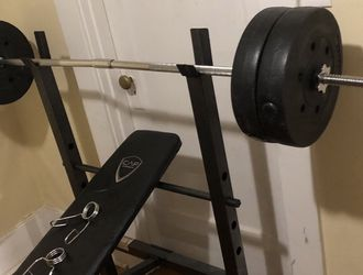 Bench Press With Weights for Sale in Beaverton,  OR