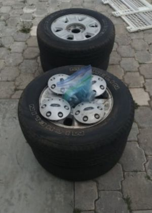 OEM Michelin tires and rims + hubcaps for 2010 Ford f150 and explorer for Sale in Bisbee, AZ