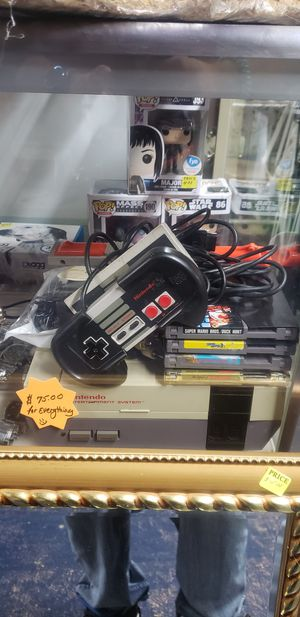 Original nintendo What's controller gun and 4 games for Sale in Woonsocket, RI