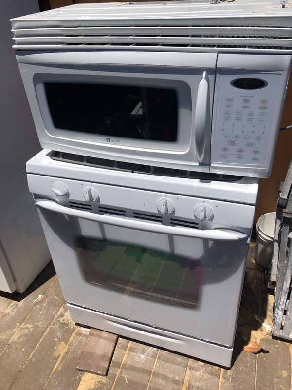 FREE REFRIGERATOR ,STOVE AND MICROWAVE IN WORKING CONDITION