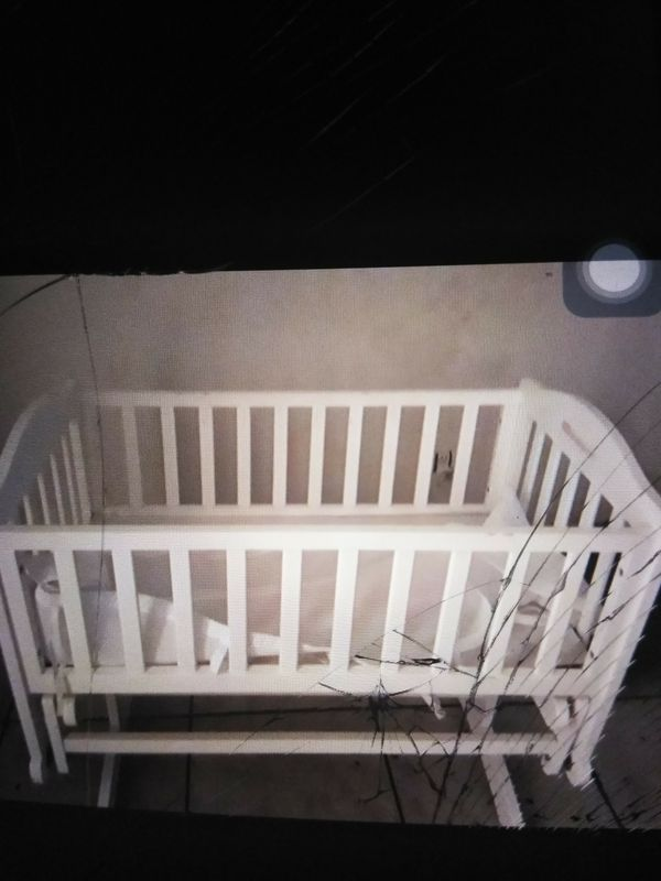 Rocker bassinet crib good condition.baby clothes included