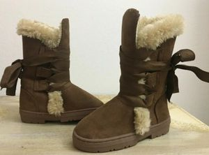 YOUTH GIRLS FAUX SUEDE LACE UP WINTER BOOTS W/ FAUX FUR for Sale in Sacramento, CA