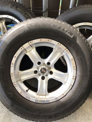 wheels and tires in good condition 4 wheels 5k and a new one had a spare part and I never used them in a Jeep Wrangler P265 / 70R17 Michelin tires for Sale in Vallejo, CA
