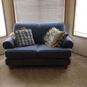 Love Seat and Sofa, Great Condition With 8 Pillows. Light blue with Light Yellow Floral Accent Pillows. for Sale in Everett, WA