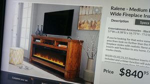 Ashley XL TV stand with fireplace for Sale in Tampa, FL