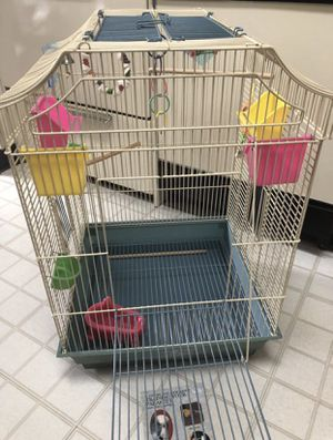 Large bird cage, plus small travel carrier, toys and feeding dishes and how-to book! for Sale in Montpelier, MD