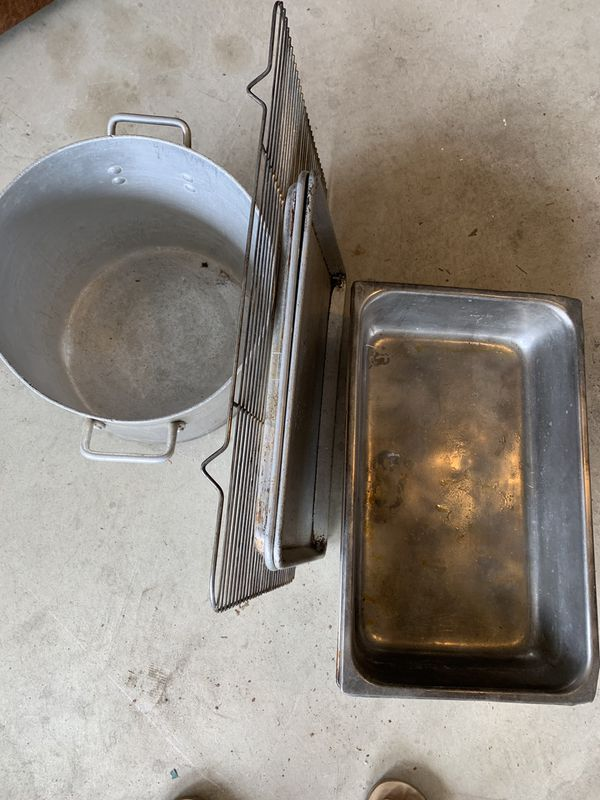 Used industrial kitchen pots and pans