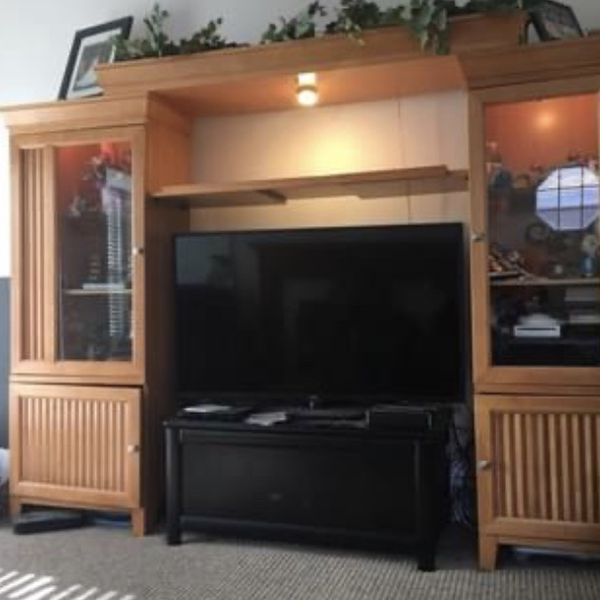 Entertainment Center With Lighted Curio Cabinents