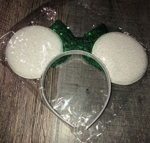 New in package over sized Minnie Mouse sequin headband w/ white ears & green bow.. A child or adult can wear this for Sale in St. Petersburg, FL
