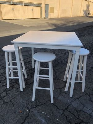 White wood dinning table and 3 stools bar height for Sale in Concord, CA