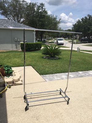 Large clothing rack with wheels for Sale in Wesley Chapel, FL
