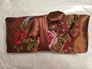 Beautiful chineese hand made jewlery or make up roll up bag. Brown with flowers. for Sale in West Valley City, UT
