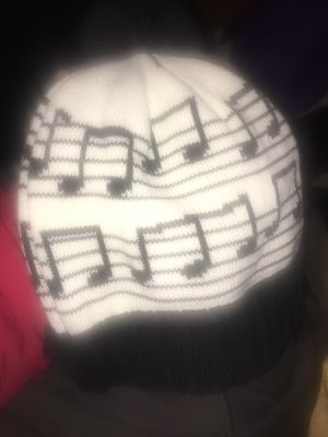 """Musical notes"" beanie with a black pouf on top*** for Sale in Vienna, VA"
