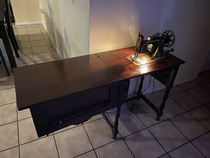 Antique New Home sewing machine and cabinet for Sale in Hollywood, FL