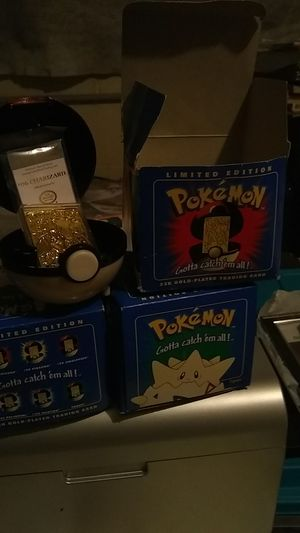 Pokemon, Charizard,Togepi rare golden cards in the Pokemon ball for Sale in Tacoma, WA