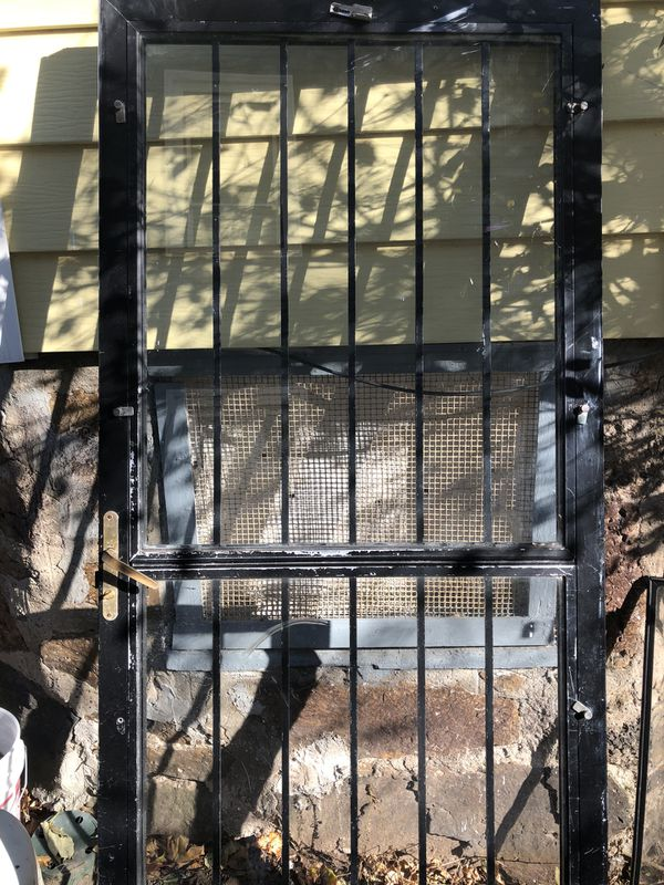 screen door with glass panel and security bars brass handle with lock 34x 80