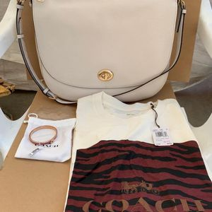 Coach Turnlock Leather Hobo Bag Coach Women's T-shirt size XL and a Coach PinkGold Hinged Bangle Iconic Glitter NWT Serious inquires only please Lo for Sale in Pico Rivera, CA