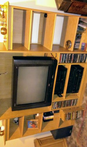 Solid entertainment center with adjustable shelving for Sale in Rockford, IL