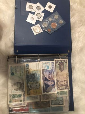 Binder of collectible real coins and bills from all over the world for Sale in Tampa, FL