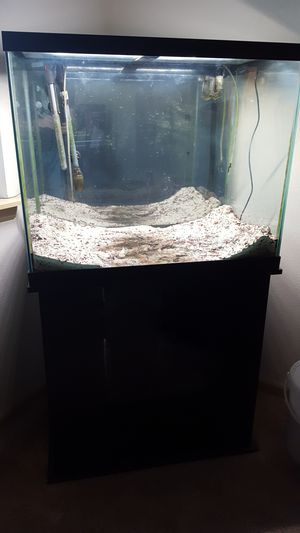55 Gallon tall glass aquarium with stand. for Sale in Saint Robert, MO