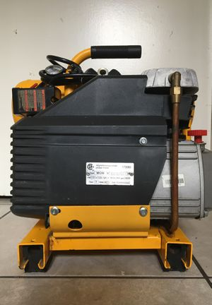 DeWALT electric compressor 4 gal twin stack in very good condition minor scratches fair price 180$ comes with a bottle of motor oil for compressor for Sale in Whittier, CA