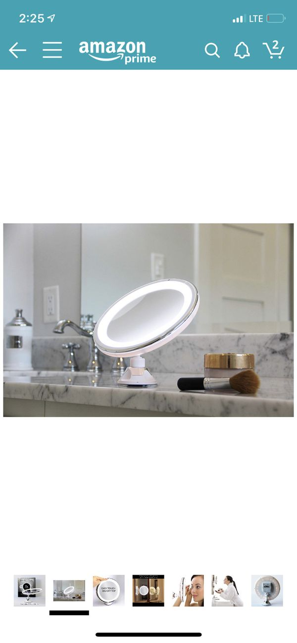 7x Magnifying Lighted Makeup Mirror. Warm LED Tap Bathroom Vanity Mirror. Wireless & Compact Travel Mirror