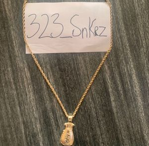 Gold 14k chain and money bag charm for Sale in Los Angeles, CA