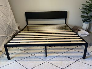 King-size metal bed frame with black faux leather headboard and room for storage for Sale in Denver, CO