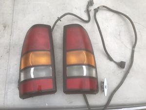1999 - 2006 Sierra Silverado tail lights & lighting harness for Sale in Lincoln Acres, CA