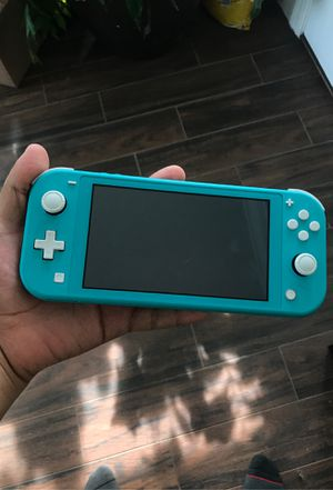 Nintendo switch light w/ 2 games for Sale in Toms River, NJ
