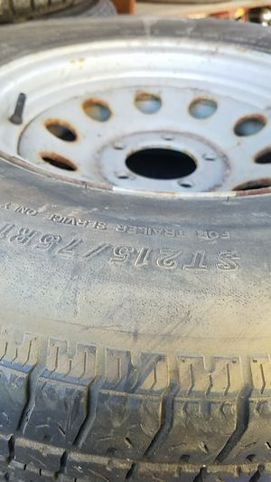 Carlisle 14 inch trailer tires with three rims for Sale in Boise, ID
