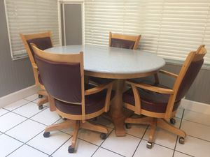 Kitchen table with corian table top 4 swivel leather chairs for Sale in Oviedo, FL