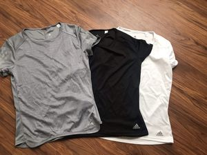 Adidas women's workout shirts in medium for Sale in Austin, TX