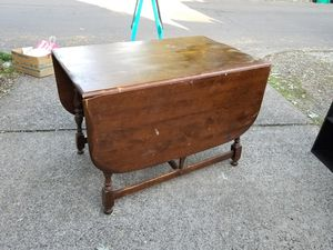 Antique Drop Leaf Table Needs Refiinished Pictures of damage posted 42W x 26 x 29.5h with leaves down 42W x 63 x 29.5h leaves open for Sale in Portland, OR