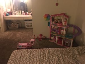 Barbie dream house and camper with barbies and accessories for Sale in Anaheim, CA