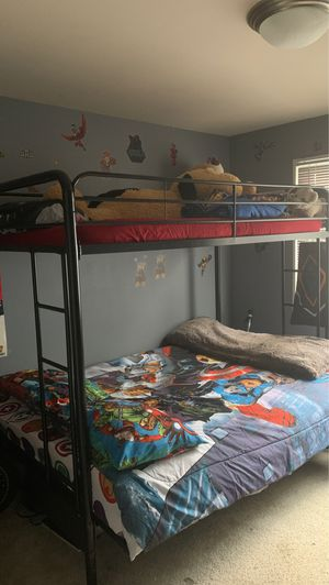 Black metal Bunk bed. Top twin size, bottom futon folds out to full size bed. for Sale in UNIVERSITY PA, MD