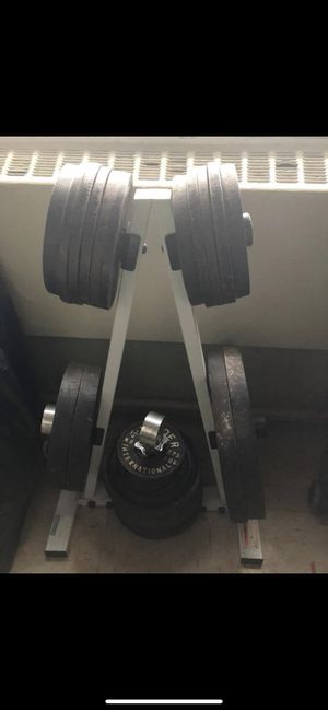 A set of 35lb Olympic plates, a set of 35lb, various 10lbs &5lbs. Plus stand, & bars. for Sale in New York, NY