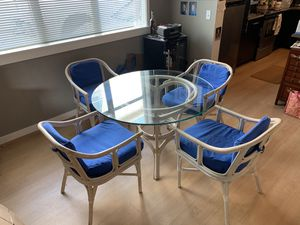 Glass top bamboo table with four chairs. Have two sets. for Sale in Manson, WA