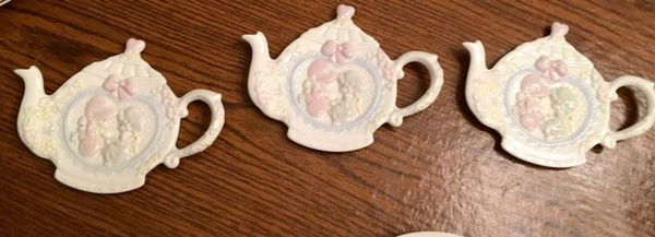 Three vintage precious moments teacup shaped items for the nursery
